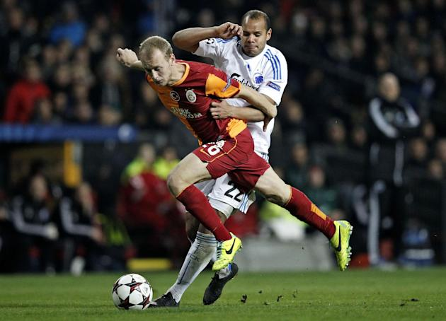 Galatasaray's Semih Kaya and FC Copenhagen's Daniel Braaten of Norway compete for the ball during their Champions League Group B soccer match at Parken Stadium, Copenhagen, Denmark, Tuesday Nov. 5, 20
