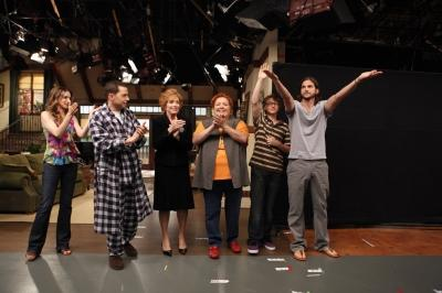 "Ashton Kutcher waves during the curtain call after filming the  season premiere episode of ""Two and a Half Men,"" alongside  Marin Hinkle, Jon Cryer, Holland Taylor, Conchata Ferrell and Angus T. Jones -- CBS"