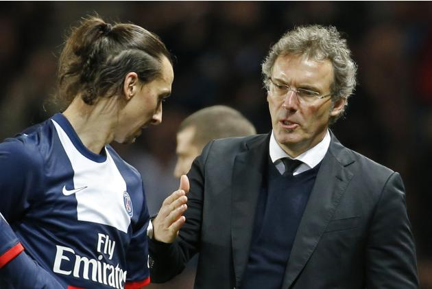 Paris Saint Germain's coach Laurent Blanc congratulates Zlatan Ibrahimovic as he returns to the bench during their French Ligue 1 soccer match against Valenciennes at Parc des Princes Stadium in P