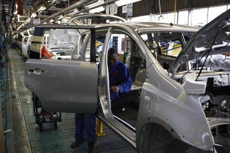 A worker assembles a car at a Nissan's manufacturing plant in Rosslyn