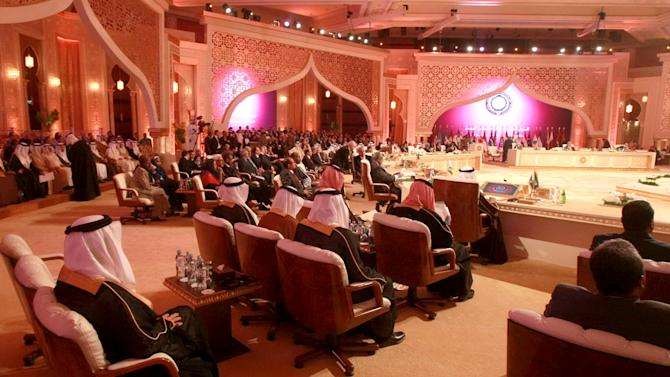 A general view of the Arab League summit in Doha, Qatar, Tuesday, March 26, 2013. Syrian opposition representatives took the country's seat for the first time at an Arab League summit that opened in Qatar on Tuesday, a significant diplomatic boost for the forces fighting President Bashar Assad's regime. In a ceremonious entrance accompanied by applause, a delegation led by Mouaz al-Khatib, the former president of the main opposition alliance — the Western-backed Syrian National Coalition — took the seats assigned for Syria at the invitation of Qatar's emir, Sheik Hamad bin Khalifa Al Thani.(AP Photo/Ghiath Mohamad)