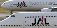 Japan Airlines (JAL) passenger aircraft stand on the tarmac of Tokyo's Haneda airport in 2010. JAL, the flag-carrier that went bust in one of the nation's biggest-ever bankruptcies, has formally applied to re-list its shares in Tokyo, reports said Wednesday