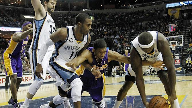 FILE - In this Nov. 23, 2012, file photo, Los Angeles Lakers guard Darius Morris, center, dives for a loose ball against Memphis Grizzlies defenders Marc Gasol (33), Mike Conley (11) and Zach Randolph during the first half of an NBA basketball game in Memphis, Tenn. Gasol, Conley and Randolph together may be the unlikeliest trio to lead a team, they have the Grizzlies in their first Western Conference final against San Antonio. (AP Photo/Lance Murphey, File)