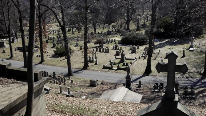FILE - This March 2, 2011 file photo shows a view over Green-Wood Cemetery in the Brooklyn borough of New York. The New York Daily News said that groundskeepers on Tuesday, Aug. 21, 2012 discovered 51 damaged and toppled plaques and statues scattered throughout the historic cemetery, which opened in 1838. (AP Photo/Seth Wenig, File)