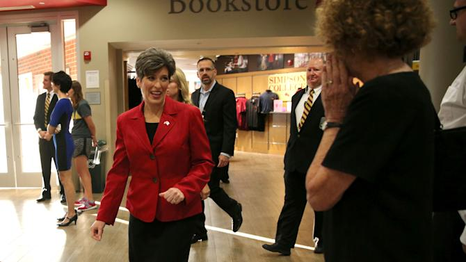 FILE - In this Sept. 28, 2014 file photo Iowa Republican senate candidate Joni Ernst, makes her way through the Kent Campus Center at Simpson College in Indianola, Iowa. Ernst cancelled a Thursday, Oct. 23, 2014 meeting with The Des Moines Register's editorial board, saying her time was better spent campaigning in Iowa. Ernst faces four-term Democratic congressman Bruce Braley. (AP Photo/Justin Hayworth, File)