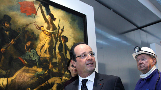 "France's President Francois Hollande, center, seen with a former miner, Lucien Laurent, right, in front of "" La Liberte Guidant le Peuple"", a painting by Eugene Delacroix, during the inauguration of the Louvre Museum in Lens, northern France, Tuesday, Dec. 4, 2012. The museum in Lens is to open on Dec. 12, as part of a strategy to spread art beyond the traditional bastions of culture in Paris to new audiences in the provinces. (AP Photo/Michel Spingler, Pool)"