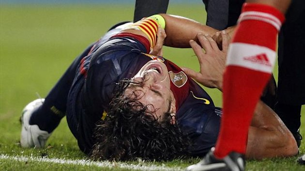Barcelona defender Carles Puyol lies injured during the Champions League win at Benfica on October 2