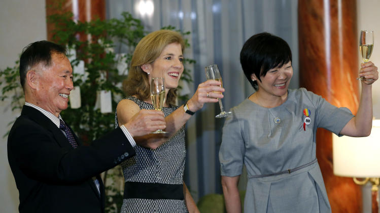 Actor George Takei, left, U.S. Ambassador to Japan Caroline Kennedy, center, and Japanese Prime Minister Shinzo Abe's wife Akie Abe toast during a reception at Kennedy's official residence Thursday, June 5, 2014, in Tokyo. Takei said he needed courage and anger to come out as gay and to join the equal rights movement for sexual minorities in the U.S., and he hopes his Japanese counterparts will do the same to make their society more equal. Takei, 77, is in Japan to attend embassy-organized events marking Lesbian, Gay, Bisexual and Transgender Pride Month in the U.S. (AP Photo/Shizuo Kambayashi, Pool)
