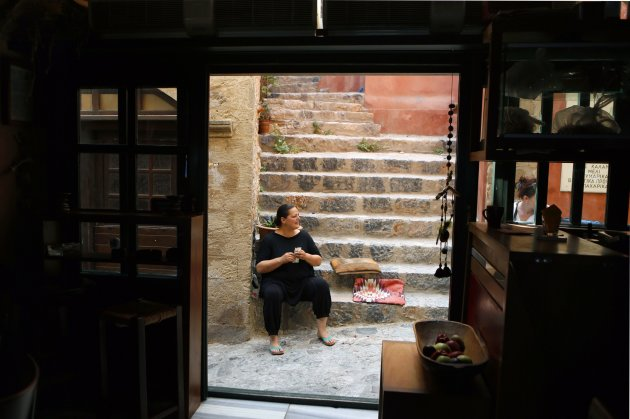 Anna Traiforou sits outside her bar inside the medieval castle of Monemvasia