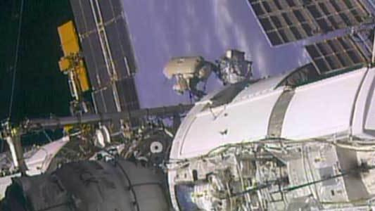Spacewalking Cosmonauts Prime Space Station for New Laboratory
