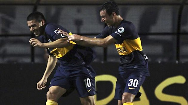 Juan Roman Riquelme (L) of Argentina's Boca Juniors celebrates with his teammate Juan Mino after scoring against Brazil's Corinthians during their Copa Libertadores soccer match in Sao Paulo (Reuters)