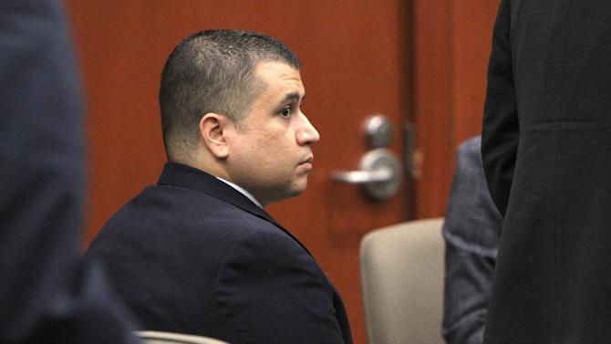 """George Zimmerman listens to testimony Friday, Oct. 26, 2012 in Sanford, Fla. The prosecutor in the case of Zimmerman, the former neighborhood watch leader accused of shooting an unarmed teenager, called the conduct of the defense lawyer """"a slippery slope"""" in pleading with the judge Friday to impose a gag order on all attorneys. (AP Photo/Orlando Sentinel, George Skene, Pool)"""