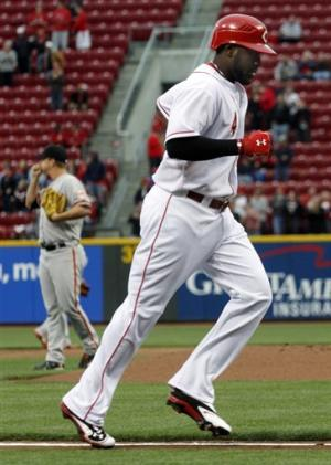 Latos gets 1st win, Reds beat Giants 9-2