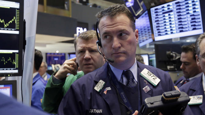 In this Friday, Jan. 25, 2013, photo, Trader Jonathan Corpina, right, works on the floor of the New York Stock Exchange. Markets were steady Wednesday Jan. 30, 2013 ahead of the U.S. Federal Reserve's first policy statement of the year, which has the potential to indicate a shift in its monetary stance. (AP Photo/Richard Drew)