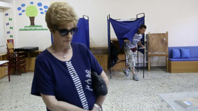 People vote at a polling station during a referendum in Athens