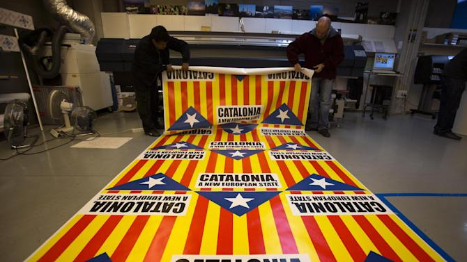 "In this photo taken on Tuesday, Nov. 13, 2012, operators prepare flags for sale that combine the slogan of EU aspiration with the red-and-yellow stripes, blue triangle and white star of the ""estelada"" flag that symbolizes Catalonia's independence drive in a printing shop in Girona, Spain. Catalonia holds elections on Sunday that will be seen as a test of the regional government's plans to hold a referendum on independence, and one of the key issues emerging is the theoretical place of a free Catalonia in Europe. (AP Photo/Emilio Morenatti)"
