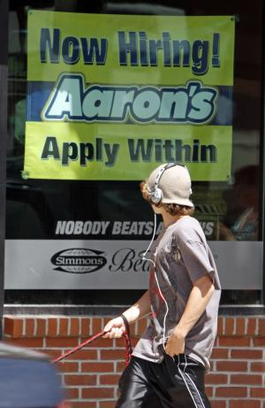 A passer by looks at a sign for jobs in Barre, Vt. on Thursday, July 7, 2011. Unemployment rises to 9.2 pct. in June, as employers add only 18,000 jobs. (AP Photo/Toby Talbot)