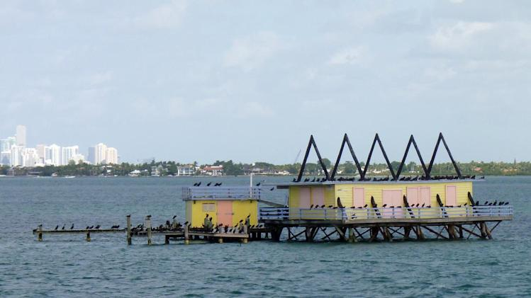 In this photo taken Sunday, Nov. 11, 2012, shows one of the seven Stiltsville homes near Miami, Fla. The narrated tour tells the colorful story of these homes perched above the shallow waters of Biscayne Bay. (AP Photo/Suzette Laboy)