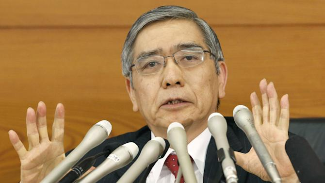 "Bank of Japan Gov. Haruhiko Kuroda speaks at a news conference at Japan's central bank headquarters in Tokyo Thursday, April 4, 2013. Japan is making a sweeping shift in its monetary policy, aiming to spur inflation and get the world's third-largest economy out of a long, debilitating slump. Bowing to demands from Prime Minister Shinzo Abe for more aggressive monetary easing, the Bank of Japan announced Thursday a policy overhaul intended to double the money supply and achieve a 2 percent inflation target at the ""earliest possible time, with a time horizon of about two years."" (AP Photo/Kyodo News) JAPAN OUT, MANDATORY CREDIT, NO LICENSING IN CHINA, HONG KONG, JAPAN, SOUTH KOREA AND FRANCE"