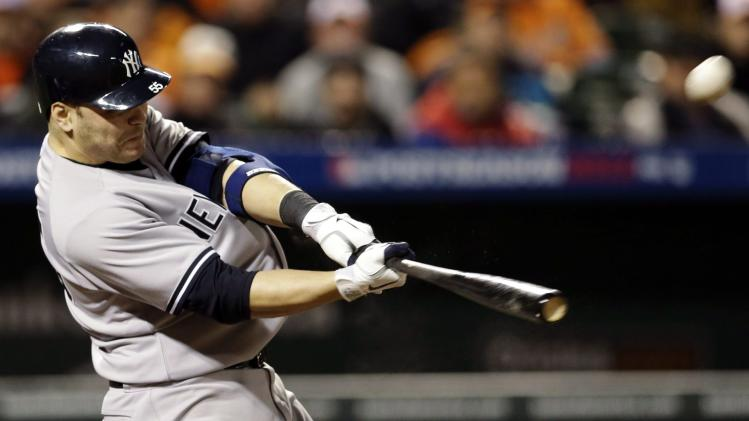 FILE - In this Oct. 7, 2012, file photo, New York Yankees Russell Martin hits a solo home run against the Baltimore Orioles during a baseball game in Baltimore. Martin, a free agent, signed a  $17 million, two-year contract on Friday, Nov. 30, 2012, with the Pittsburgh Pirates.(AP Photo/Patrick Semansky, File)