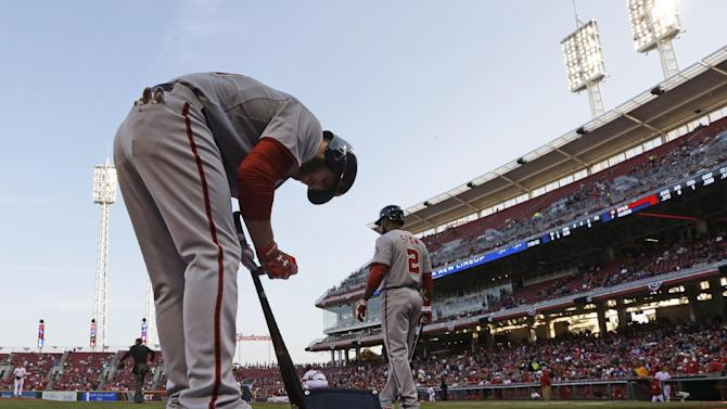 Washington Nationals' Bryce Harper prepares to bat against the Cincinnati Reds in the first inning of a baseball game, Friday, April 5, 2013, in Cincinnati. (AP Photo/Al Behrman)