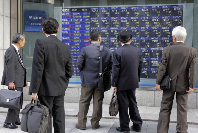 People look at an electronic stock board of a securities firm in Tokyo, Friday, Oct. 26, 2012. Asian stock markets fell Friday after the latest data on U.S. housing dimmed hopes of improvement in an industry that is crucial to recovery in the world&#39;s No. 1 economy. Japan&#39;s Nikkei 225 index fell 0.9 percent to 8,973.97. (AP Photo/Koji Sasahara)