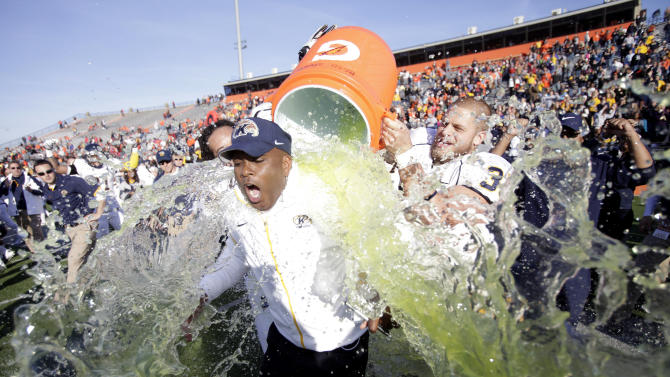 Kent State head coach Darrell Hazell gets doused by his players after they defeated Bowling Green 31-24 in an NCAA college football game, Saturday, Nov. 17, 2012, in Bowling Green, Ohio. (AP Photo/J.D. Pooley)