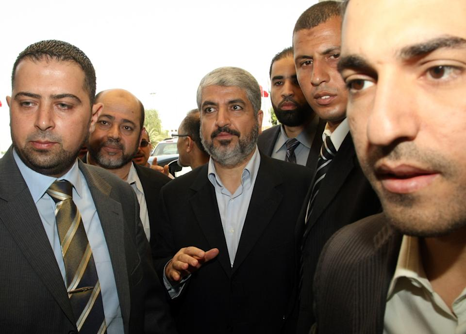 Hamas leader Khaled Mashaal arrives at the Islamist Ennahda party congress in Tunis, Thursday, July, 12, 2012. The moderate Islamist Ennahda party was elected after a transition period following the January 2011 ouster of Zine El Abidine Ben Ali. (AP Photo/Amine Landoulsi)