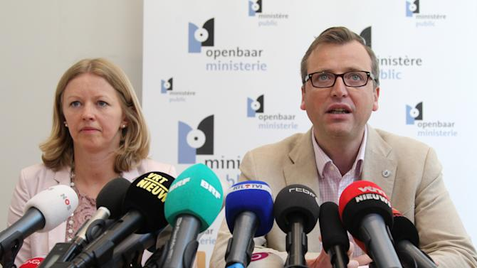 Prosecutor spokespersons Jean-Marc Meilleur, right, and Anja Bijnens address the media in Brussels, Wednesday, May 8, 2013. Police carried out a series of raids in Belgium and detained 31 people in three countries in connection with a spectacular $50 million diamond heist pulled off with apparent clockwork precision at Brussels Airport, a Belgian prosecutor said Wednesday. (AP Photo/Yves Logghe)