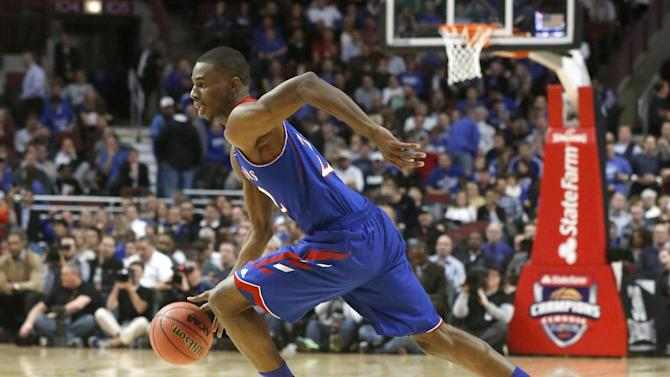 Kansas guard Andrew Wiggins drives to the basket during the second half of an NCAA college basketball game against Duke, Tuesday, Nov. 12, 2013, in Chicago