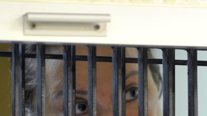 In this photo released by Mexico's federal court system, the head of Mexico's powerful teachers' union, Elba Esther Gordillo, stands behind bars as she appears for a hearing at a federal prison in Mexico City, Wednesday, Feb. 27, 2013. Gordillo was charged with embezzling 2 billion pesos (about $160 million) from union funds, as well as organized crime. The judge in the case said a decision about whether the evidence is sufficient to merit a trial would be taken in three to six days. (AP Photo/Juzgado Sexto de Distrito en Procesos Penales Federales)