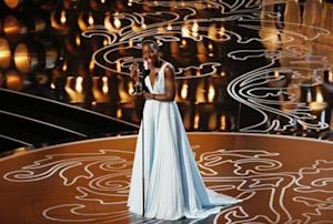 "Nyong'o, best supporting actress winner for her role in ""12 Years a Slave"", racts on stage at the 86th Academy Awards in Hollywood"