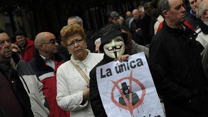 Protesters take part in a May Day demonstration in Gijon