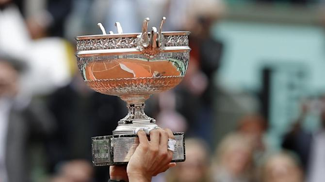 Spain's Rafael Nadal raises the cup after defeating Serbia's Novak Djokovic in their men's final match in the French Open tennis tournament at the Roland Garros stadium in Paris, Monday, June 11, 2012. Nadal pass Bjorn Borg as the all-time record-holder for French Open titles. (AP Photo/Bernat Armangue)