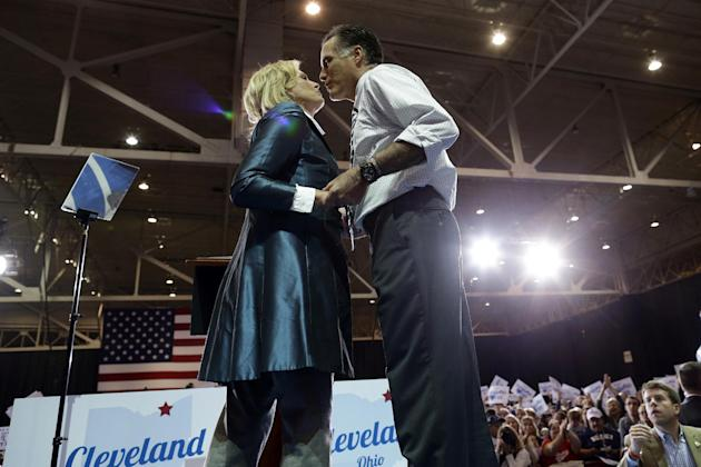 Republican presidential candidate and former Massachusetts Gov. Mitt Romney leans over to kiss his wife Ann after she introduced him as they campaign at the International Exposition Center in Clevelan