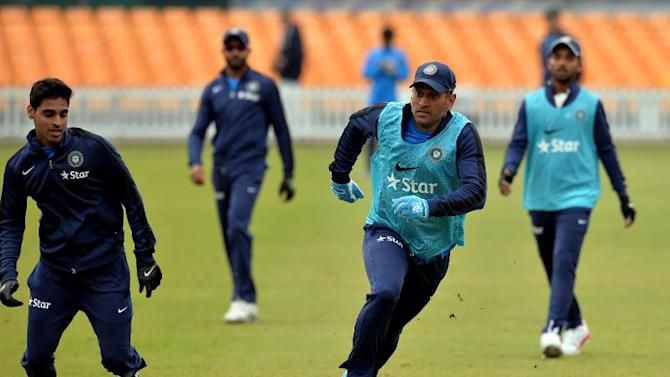India cricket captain MS Dhoni plays football during a warm up sesion before play on the third day of the cricket match between Leicestershire and India at Grace Road in Leicester, England on June 28, 2014