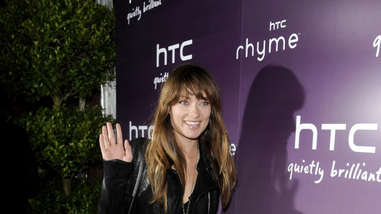 "Actress Olivia Wilde attends the ""HTC Serves Up NYC"" product launch event at Highline Stages on Tuesday, Sept. 20, 2011 in New York. (AP Photo/Evan Agostini)"