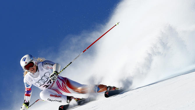 Liechtenstein's Tina Weirather speeds down the course on her way to win an alpine ski, women's World Cup super-G, in St. Moritz, Switzerland, Saturday, Dec. 14, 2013. (AP Photo/Marco Trovati)