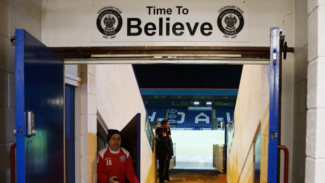 A man works in the tunnel before Rochdale and Stoke City's English FA Cup 4th round soccer match in Rochdale