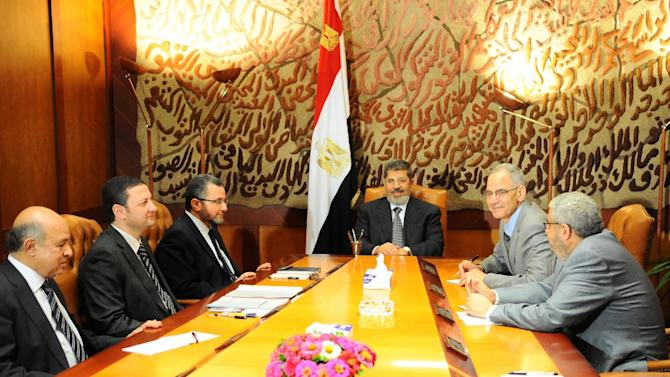 This image released by the office of the Egyptian Presidency on Monday, July 1, 2013, Mohammed Morsi, center, meets with members of his government leadership in Cairo, Egypt, Monday, July 1, 2013. Egypt's military on Monday issued a 48-hour ultimatum to the Islamist president and his opponents to reach an agreement or it will intervene to put forward a political road map for the country and ensure it is carried out. (AP Photo/Egyptian Presidency)