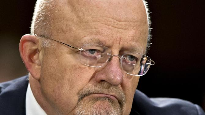 """FILE - This April 18, 2013 file photo shows National Intelligence Director James Clapper testifying on Capitol Hill in Washington. Clapper is apologizing for telling Congress earlier this year that the National Security Agency does not collect data on millions of Americans. In a letter to Senate Intelligence Committee Chairwoman Sen. Dianne Feinstein, D-Calif., Clapper says his answer was """"clearly erroneous."""" (AP Photo/J. Scott Applewhite, File)"""