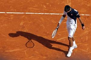 Djokovic reacts after missing a point during his match against Federer during their semi-final match at the Monte Carlo Masters in Monaco