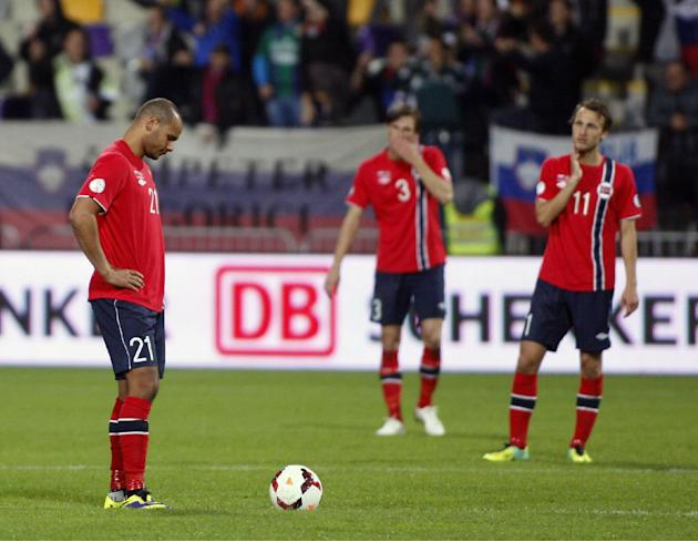 Norway's Daniel Braaten, left, Johan Lodre Bjordal and Magnus Wolff Eikrem, right, look dejected after receiving third goal during the 2014 World Cup group E qualifier soccer match between Slovenia an
