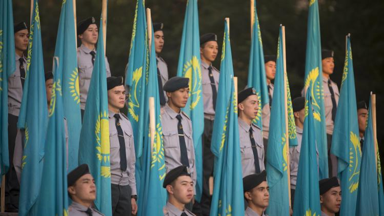 Kazakh cadets stand beside national flags during the Constitution Day celebrations in Almaty