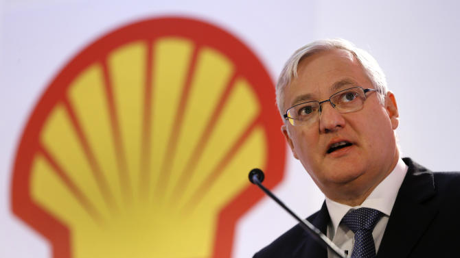 FILE - In this Jan. 31, 2013 file photo Peter Voser, Chief Executive Officer of Shell, speaks at the Royal Dutch Shell's full year results 2012 press conference, in London. Royal Dutch Shell PLC announced Thursday May 2, 2013 Peter Voser will step down in early 2014. Voser has led Shell since July 2009. Royal Dutch Shell PLC has reported lower profits for the first quarter, as a decline in oil prices offset improved earnings from its refining arm. (AP Photo/Kirsty Wigglesworth, File)
