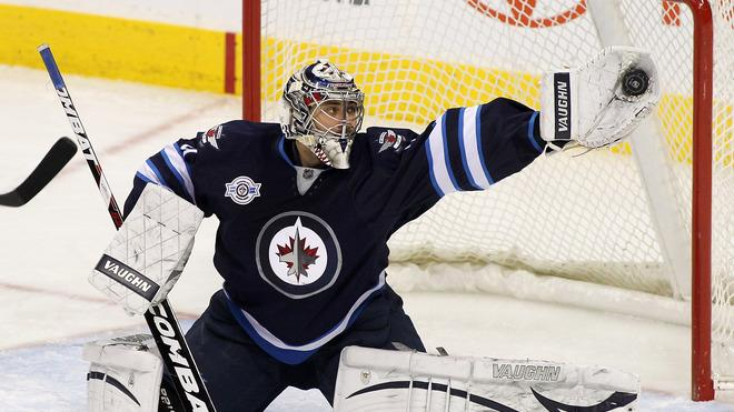 Ondrej Pavelec #31 Of The Winnipeg Jets Makes Getty Images