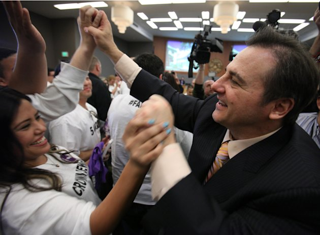 Gavin Maloof, co-owner of the Sacramento Kings, celebrates with Kings fans after the Sacramento City Council approved a plan to help finance a new $391 sports and entertainment arena, in Sacramento, Calif. Tuesday, March 6, 2012. By a 7-2 vote, the City Council approved a non-binding term sheet, signed off by the Kings and the NBA last week, that will keep the team in Sacramento for at least another 30 years.(AP Photo/Rich Pedroncelli)