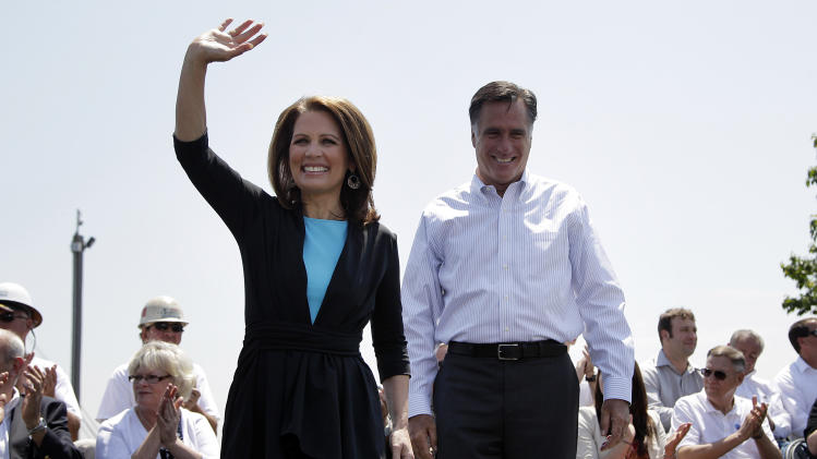 Republican presidential candidate, former Massachusetts Gov. Mitt Romney and Rep. Michele Bachmann, R-Minn., arrive at a campaign stop in Portsmouth, Va., Thursday, May 3, 2012. (AP Photo/Jae C. Hong)