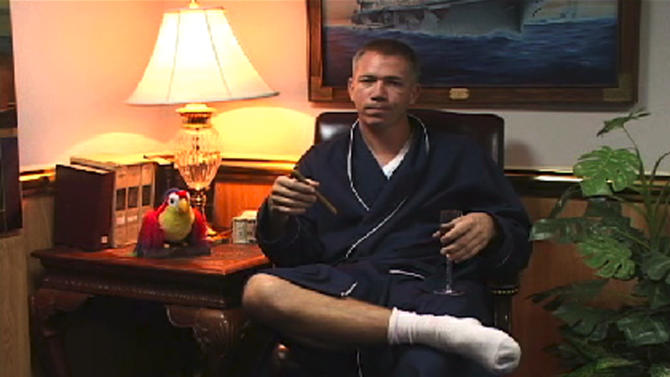 In this frame grab taken from video provided to the Virginian-Pilot newspaper, U.S. Navy Capt. Owen Honors appears in one of a series of profanity-laced comedy sketches that were broadcast on the USS Enterprise via closed-circuit television. A top officer aboard a nuclear-powered aircraft carrier broadcast to his crew the series of sketches in which he uses gay slurs, mimics masturbation and opens the shower curtain on women pretending to bathe together, a newspaper reported. The Virginian-Pilot reported in its Sunday editions that Capt. Owen Honors appeared in the videos in 2006 and 2007 while he was the USS Enterprise's second-ranking officer, and showed them across the ship on closed-circuit television. He took over as the ship's commander in May. (AP Photo/The Virginian Pilot) NO SALES