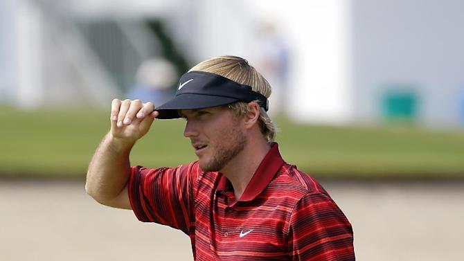 Russell Henley tips his hat after making a par putt on the ninth green during the second round of the McGladrey Classic golf tournament on Friday, Oct. 24, 2014, in St. Simons Island, Ga. (AP Photo/Stephen B. Morton)